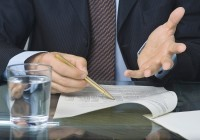 businessman signing an agreement after negotiation in the meeting room ** Note: Slight graininess, best at smaller sizes